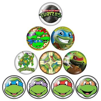 Fashion ninja turtles cartoon 10pcs Round 12mm/18mm photo glass cabochon snap buttons silver/golden/crystal styles ZB0544