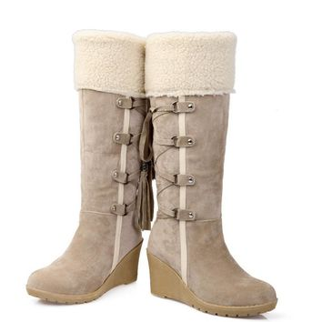 After the frosted with tassel tall canister boots Beige