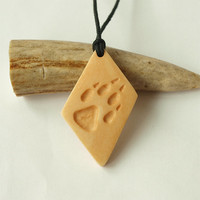 Hand carved -  wolf paw necklace pendant charm print handcrafted out of cow bone