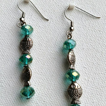 Teal earrings with silver fish beads.  2 1/2 Inches long.