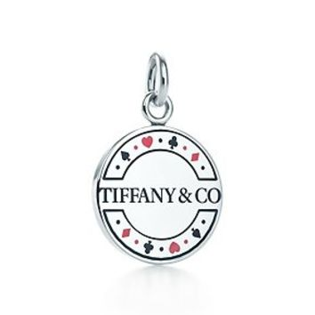 Tiffany & Co. -  Las Vegas double-sided chip charm in sterling silver with enamel finish.