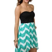 strapless high low dress with cinched bust and chevron print skirt