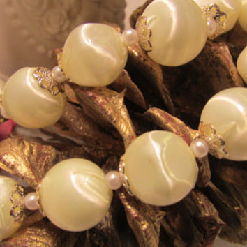 Vintage Lightweight Two Strand Plastic Beads In A Pale Yellow.