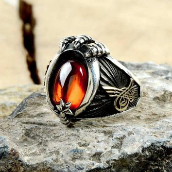 Amber gemstone with crescent star claw silver mens ring