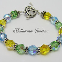 Sunshine Bracelet Featuring Real Swarovski Blue, Yellow and Green Crystals and Bali Silver Beads by Bellissima Jewelers