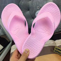 NIKE new fashion casual men and women flip-flops shoes Pink