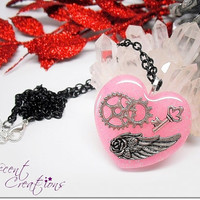 Steampunk style charm necklace, glittery soft pink resin heart pendant, gears wing key resin charm on black chain necklace, kawaii necklace