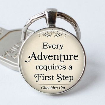 """Cheshire Cat Quote Key Chain """" Every Adventure Requires A First Step """" Alice In Wonderland Glass Dome Jewelry"""