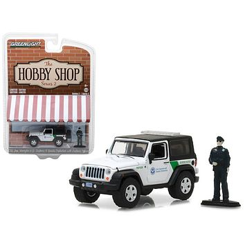 """2016 Jeep Wrangler US Customs and Border Protection with Officer \""""The Hobby Shop\"""" Series 2 1/64 Diecast Model Car by Greenlight"""