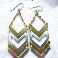 Matte gold and silver metal chevron earrings.