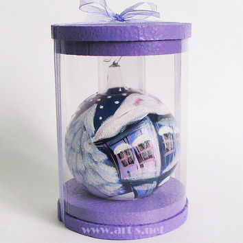 Hand-painted blown- glass Christmas ball in a gift box. For Christmas and New Year's tree decoration. Blue houses patterns.