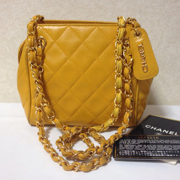 Vintage CHANEL lucky fortune color of yellow, lambskin classic chain shoulder bag with a CC stitch mark and golden chain strap. Daily purse