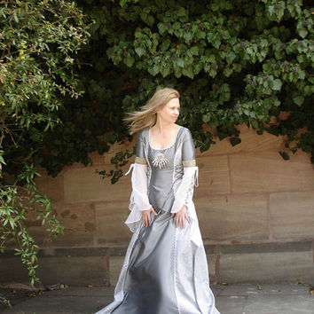 Silver wedding dress with lacing in the sleeves and the sides