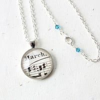 March birthday necklace.  Pendant made with vintage sheet music on silver chain with aquamarine blue crystals