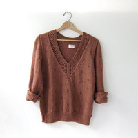 70s brown sweater. cut out sweater. copper brown pullover. deep v neck sweater.