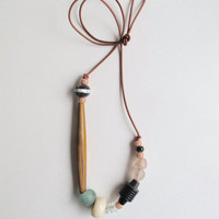 Beaded asymmetrical necklace with Native American glass beads geometric African horn and glass beads and Indian wood beads Summer fashion