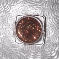 Shade name ( Cocoa ). Rich brown loose glitter pigment.  4 grams of product in a jar with sifter and seal. Vegan and cruelty free.