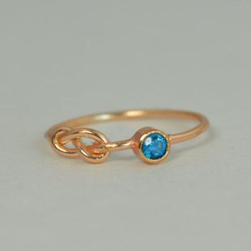 Solid 14k Rose Gold Blue Zircon Infinity Ring