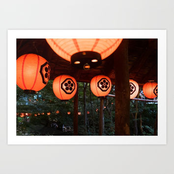 Japanese paper lanterns in the forest by Nagarekawa