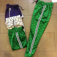 Gucci new couple sports pants Logo full printed breathable spandex cotton trousers casual men and women paragraph trousers Green