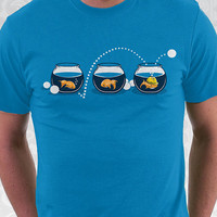 Prepared Fish T-shirt - 100% Cotton. Mens, womens and kids sizes. A fun carnival goldfish on sapphire, royal, & baby blue.