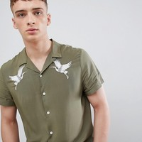 River Island revere collar shirt with crane embroidery in khaki at asos.com