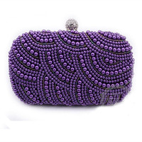 Solid Overlapping Pearl Beaded Clutch