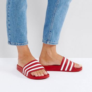 adidas Adilette Slider Sandals In Red at asos.com