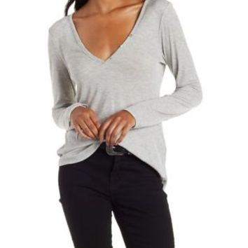 Long Sleeve V-Neck Henley Top by Charlotte Russe