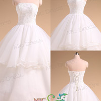 Strapless sleeveless floor-length organza tiered with appliques wedding dress