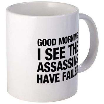 GOOD MORNING I SEE THE ASSASSINS HAVE FAILED MUGS