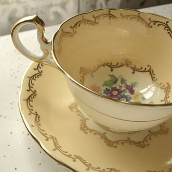 antique yellow tea cup and saucer set, 1930's Aynsley English bone china tea set, gold, flowers