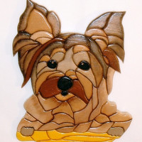 This Little  Dog is a Yorkshire Terrier, it is a wood sculptured wall art.