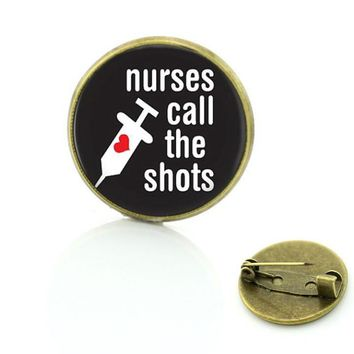"Vintage Nurse ""Call The Shots"" Glass Cabochon Brooches"
