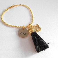 Gold Infinity Bracelet With Tassel And Rhinestone Charm Black Or White