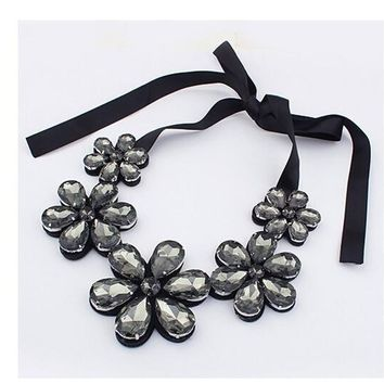 New Design Elegant Statement Big Gem Crystal Flower Ribbon Necklace For Women!!   Available in Clear, Gold and Gunmetal Gray Crystals!!   Great Deals at Great Prices!!   ***FREE SHIPPING***