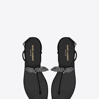 Saint Laurent NU PIED Bow T Strap Flat Sandal In Black Leather And Clear Crystal Studs | ysl.com