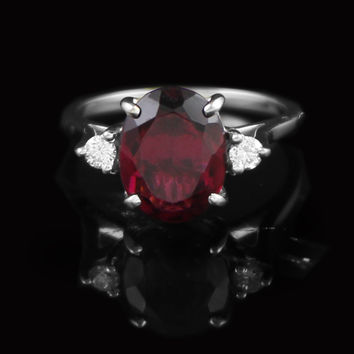 Oval Rhodolite Garnet Ring with Diamond Accent Sides