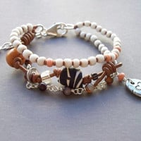 Beaded bracelet - African trade beads jewelry - Multi layer bracelet with an Artist silver charm, handknotted bracelet