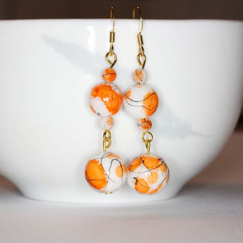 Orange dangle earrings Glass beads earrings Orange and white earrings Orange painted earrings Handmade earrings Handmade orange earrings