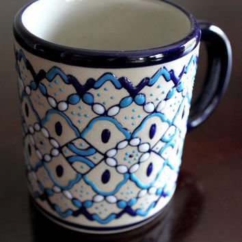 Ceramic handmade Mug, a coffee or tea cup by Servin Pottery, hand painted with white and blue glaze.