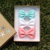 Aqua, white denim, and pink chambray hair bows from Seaside Sparrow.  Seaside Sparrow bows make the perfect birthday gift.