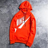 NIKE New fashion bust hook print men hooded long sleeve sweater top Red