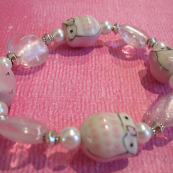 Pink Ceramic Owl Bracelet with Pink Cats Eye, White Glass Pearls, and Silver-Plated Accents