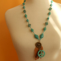 Long necklace, turquoise, feathers,flowers,peace boho chic