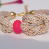 Infinity Knot Knitted Bracelet. Crocheted Beige Cotton Yarn Bracelet with Acrylic Neon Pink Bead.