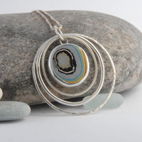 Sterling silver and fordite frame pendant