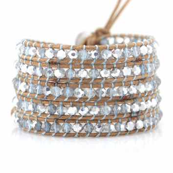 Clear and Silver Crystals with Blue Thread on Natural