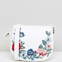 London Rebel Saddle Bag with Foral Embroidery at asos.com