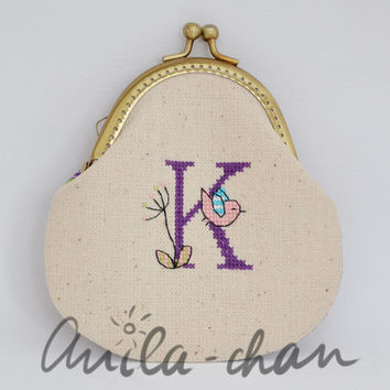 "Hand-embroidered personalized blue purse ""My name is K..."""